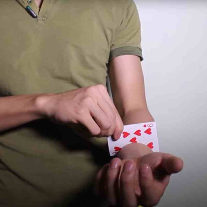 card-through-arm-trick